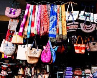 Colourful fabrics hang outside Ubud market (c) Clarice Fong